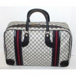 vintage 1980s gucci logo carry on suitcase