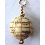 antique scrimshaw globe pendant